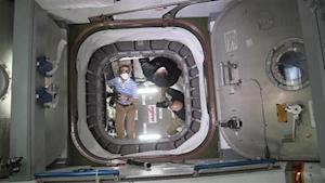 The International Space Station crew opens a hatch to begin unloading cargo in this NASA handout photo