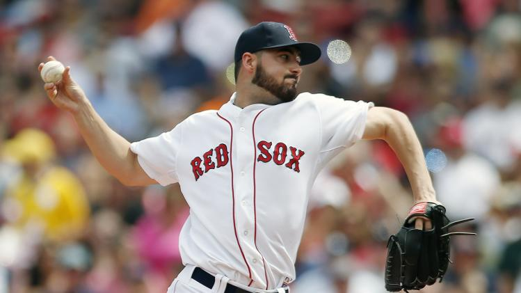 Boston Red Sox's Brandon Workman pitches during the first inning of a baseball game against the Seattle Mariners in Boston, Saturday, Aug. 23, 2014. (AP Photo/Michael Dwyer)