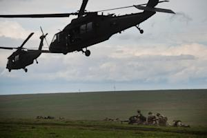 British servicemen under US Army choppers during NATO …