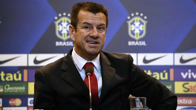 "Brazil's 1994 World-Cup winning skipper Carlos Verri, better known as ""Dunga"", speaks during his presentation as new coach of the Brazilian national football team, in Rio de Janeiro, on July 22, 2014"