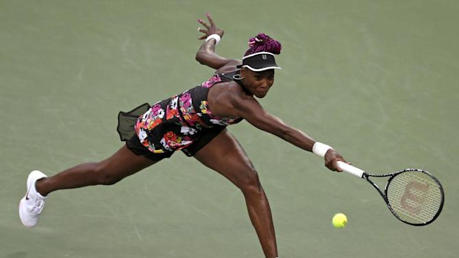 Venus Williams lunges for a shot against Jie Zheng, of China, during the second round of the 2013 U.S. Open tennis tournament, Wednesday, Aug. 28, 2013, in New York. (AP Photo/Charles Krupa)