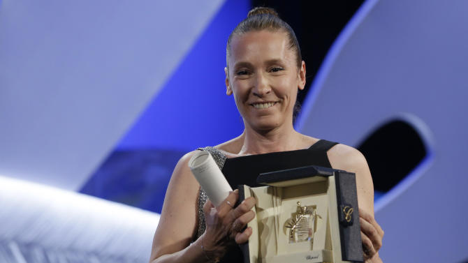 Actress Emmanuelle Bercot holds the Best Actress award for the film Mon Roi during the awards ceremony at the 68th international film festival, Cannes, southern France, Sunday, May 24, 2015. The award was shared with actress Rooney Mara for the film Carol. (AP Photo/Lionel Cironneau)