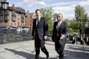 British Prime Minister David Cameron, left, walks with Mass. Gov. Deval Patrick into the Massachusetts Statehouse in Boston, Monday, May 13, 2013. Cameron met with Patrick to offer his condolences and discuss lessons that can be learned from the Boston Marathon attacks. (AP Photo/Elise Amendola)