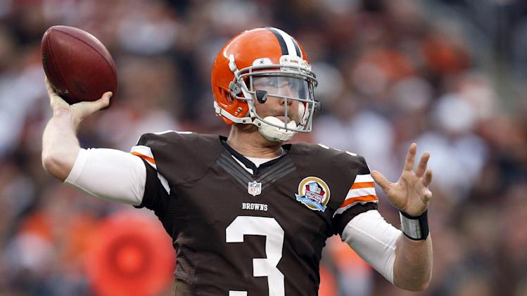 Cleveland Browns quarterback Brandon Weeden passes against the Washington Redskins in the third quarter of an NFL football game on Sunday, Dec. 16, 2012, in Cleveland. (AP Photo/Rick Osentoski)