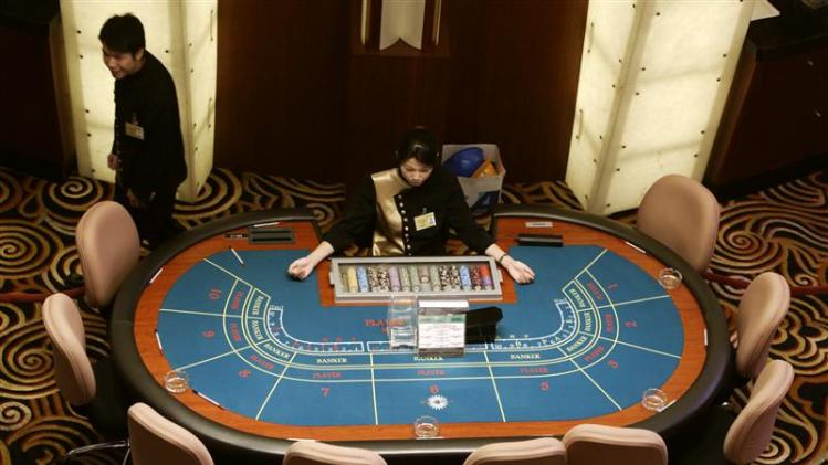 File photo of croupiers preparing to greet visitors at Sands Macau casino in Macau
