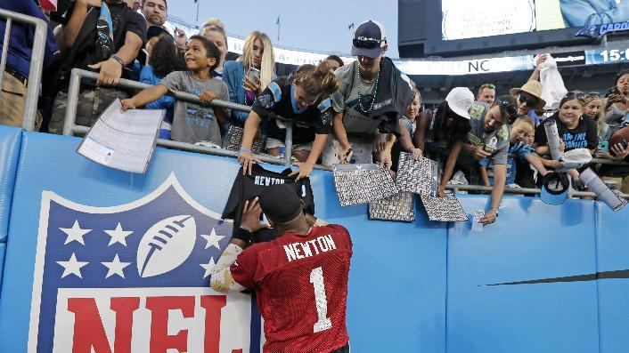 Carolina Panthers' Cam Newton signs autographs for fans after an NFL football practice at the team's Fan Fest in Charlotte, N.C., Friday, July 25, 2014. (AP Photo)