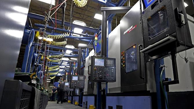 """This Friday, Jan. 11, 2013, photo, shows the Doosan V550M at Webb Wheel Products in Cullman, Ala. According to Dwayne Ricketts, the president of Webb Wheel Products, the Doosan V550M can """"drill holes on both sides of a 130-pound brake drum without missing a beat, and it doesn't take vacations or complain about anything.""""(AP Photo/Dave Martin)"""