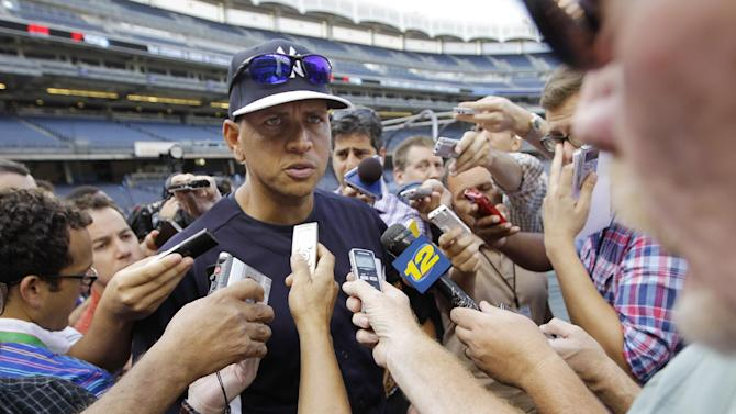 New York Yankees' Alex Rodriguez addresses a media swarm before a baseball game against the Toronto Blue Jays at Yankee Stadium, Wednesday, Aug. 21, 2013, in New York. (AP Photo/Kathy Willens)