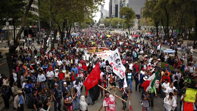 Teachers from different parts of Mexico protest education reform in Mexico City, Wednesday, Sept. 4, 2013. Striking teachers are protesting after Mexico's Senate overwhelmingly passed a sweeping reform of Mexico's public school system early Wednesday, handing President Enrique Pena Nieto an important victory in his push to remake some of his country's institutions. (AP Photo/Ivan Pierre Aguirre)