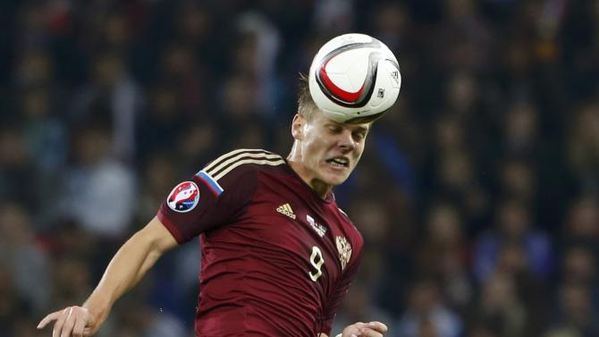 Russia's Kokorin jumps for header next to Sweden's Forsberg during their Euro 2016 group G qualification match at Otkrytie Arena stadium in Moscow
