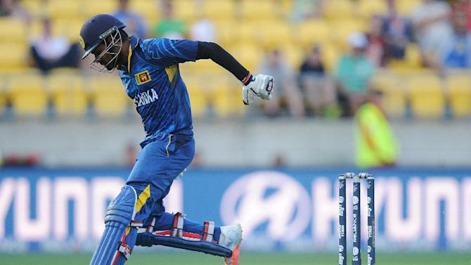 Sri Lanka's Lahiru Thirimanne drops his bat while running to make his ground while batting against Engalnd during their Cricket World Cup match in Wellington, New Zealand, Sunday, March 1, 2015. (AP Photo Ross Setford)
