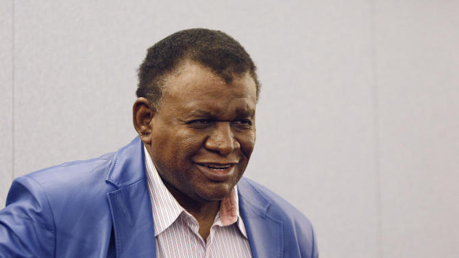 Comedian George Wallace smiles in court in Las Vegas on Tuesday, April 8, 2014 after a jury awarded him $1.3 million in his case against the Bellagio hotel-casino for a 2007 incident where he was injured on stage. (AP Photo/Las Vegas Review-Journal, John Locher)