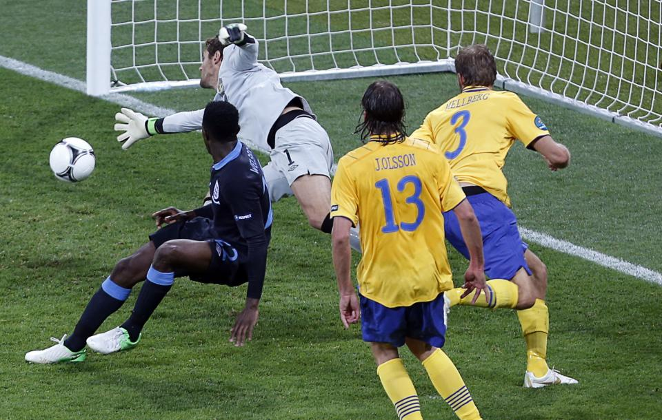 England's Danny Welbeck, left, scores his side's third goal past Sweden goalkeeper Andreas Isaksson, 2nd left, during the Euro 2012 soccer championship Group D match between Sweden and England in Kiev, Ukraine, Friday, June 15, 2012. (AP Photo/Darko Vojinovic)