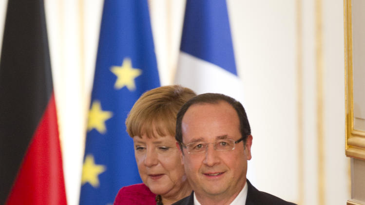 Hollande, Merkel call for full-time eurozone boss