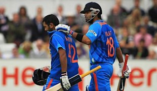 Kohli consoles Parthiv after he missed a hundred.