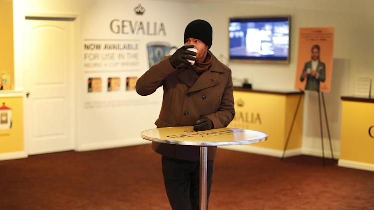 IMAGE DISTRIBUTED FOR GEVALIA - Tomas Martin, 31, from West Palm Beach, Fla., enjoys Gevalia coffee at a temporary store at 253 West 47th Street to treat New Yorkers and visitors to free cups of premium Gevalia coffee through Dec. 31, on Thursday, Dec. 27, 2012, in New York. (John Minchillo /AP Images for Gevalia)