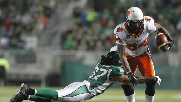 BC Lions' wide receiver Arceneaux gets tackled by Saskatchewan Roughriders' defensive back Williams during the second half of their CFL football game in Regina