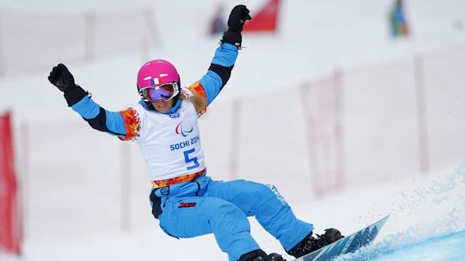 Cecile Hernandez Ep Cervellon of France competes during women's para snowboard cross, standing event at the 2014 Winter Paralympic, Friday, March 14, 2014, in Krasnaya Polyana, Russia