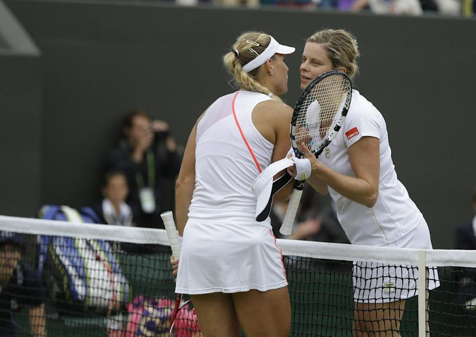 Angelique Kerber of German, left, is congratulted by Kim Clijsters of Belgium after winning a fourth round singles match at the All England Lawn Tennis Championships at Wimbledon, England, Monday, July 2, 2012. (AP Photo/Alastair Grant)