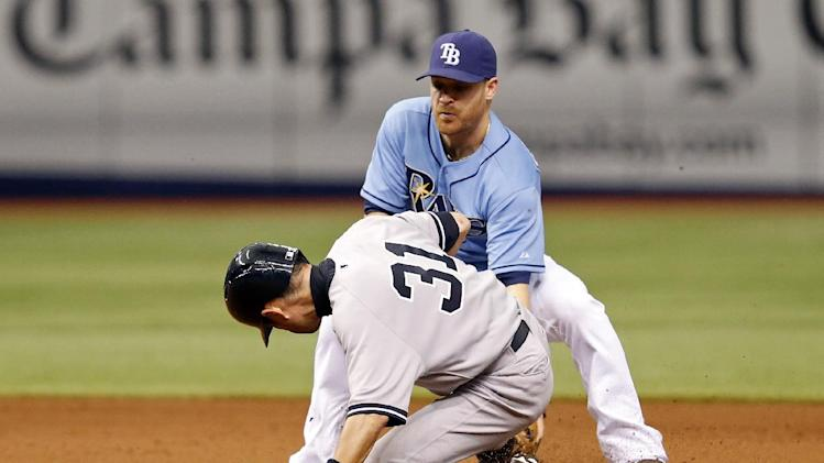 Tampa Bay Rays second baseman Logan Forsythe, top, tags out New York Yankees' Ichiro Suzuki on a steal-attempt at second base during the 11th inning of a baseball game on Sunday, April 20, 2014, in St. Petersburg, Fla. The original call of safe was overturned on appeal and video review. (AP Photo/Mike Carlson)