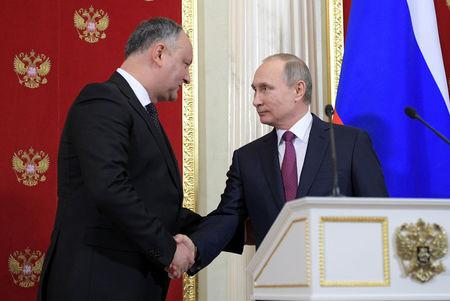 In Russia, Moldovan president says he may scrap EU trade pact