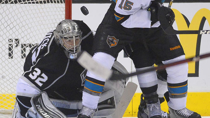 Los Angeles Kings goalie Jonathan Quick (32) looks for the rebound as he blocks  a shot against the San Jose Sharks in the second period during Game 5 of the Western Conference semifinals in the NHL hockey Stanley Cup playoffs, Thursday, May 23, 2013, in Los Angeles. (AP Photo/Mark J. Terrill)