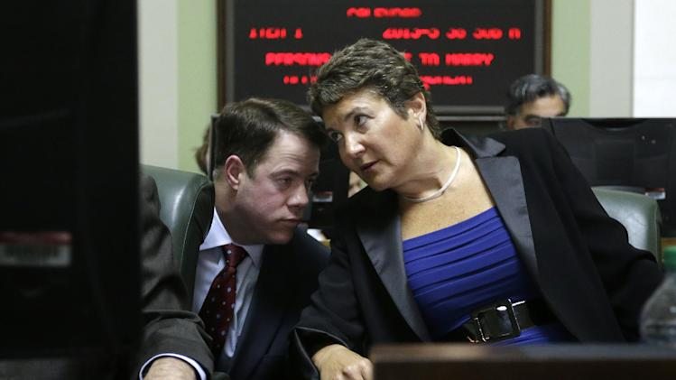 Rhode Island State Sen. President Chief of Staff Tom Coderre, left, speaks with R.I. Sen. Donna Nesselbush, D-Pawtucket, right, on the floor of the Senate Chamber before a vote on a same-sex marriage bill at the Statehouse, in Providence, R.I., Wednesday, April 24, 2013. The bill, of which Nesselbush was the main sponsor, passed. (AP Photo/Steven Senne)
