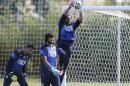 Italy's Gianluigi Buffon catches the ball as teammates Salvatore Sirigu, left, and Mattia Perin stand by as they train in Mangaratiba, Brazil, Thursday, June 12, 2014. Italy plays in group D at the World Cup. (AP Photo/Antonio Calanni)
