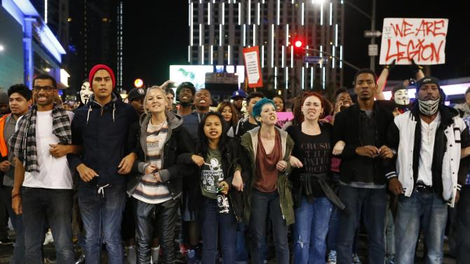 Protesters block an intersection during a march in Los Angeles, California