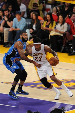 Lakers snap 4-game skid with 103-94 win over Magic
