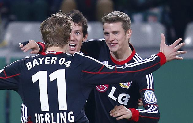 Bayer Leverkusen's Kiessling, Kruse and Bender celebrate Kruse's goal against SC Freiburg during their DFB Pokal third round match in Freiburg
