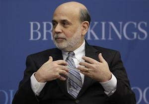 Outgoing U.S. Federal Reserve Board Chairman Bernanke participates in a discussion at the Brookings Institution in Washington