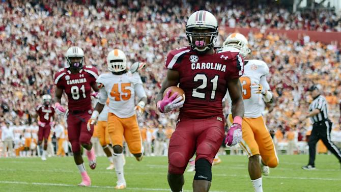 South Carolina running back Marcus Lattimore scores a touchdown during the second quarter of an NCAA college football game against Tennessee, Saturday, Oct. 27, 2012, at Williams-Brice Stadium in Columbia, S.C.(AP Photo/Richard Shiro)