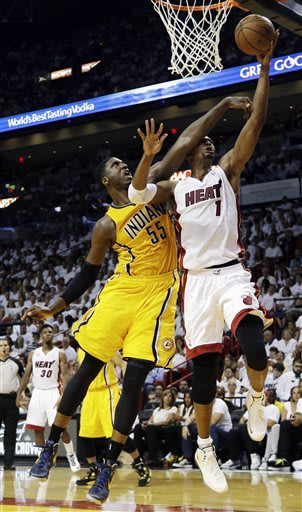 Indiana Pacers center Roy Hibbert (55) defends Miami Heat center Chris Bosh (1) as he drives to the basket during the second half of Game 1 in their NBA basketball Eastern Conference finals playoff se