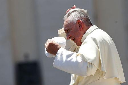 Pope Francis changes skull cap during Wednesday general audience in Saint Peter's square at the Vatican