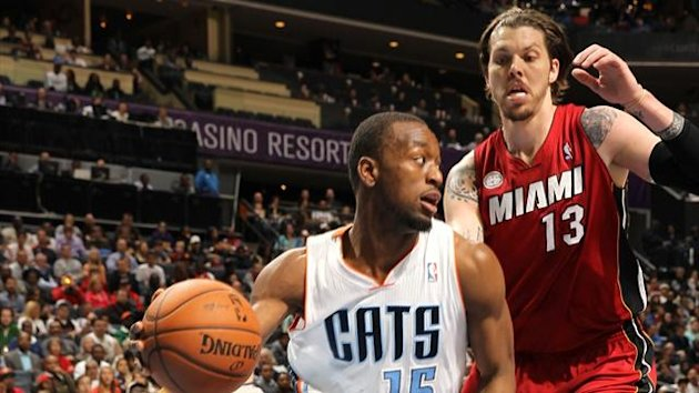 Kemba Walker #15 of the Charlotte Bobcats drives against Mike Miller #13 of the Miami Heat at the Time Warner Cable Arena (AFP)