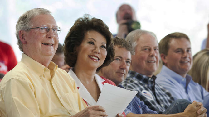From left, U.S. Sen. Mitch McConnell, 24th U.S. Secretary of Labor and McConnell's wife Elaine Chao, U.S. Sen. Rand Paul, Rep. Ed Whitfield and Kentucky Department of Agriculture James Comer listen to Gov. Steve Beshear speak during the 134th Fancy Farm Picnic in Fancy Farm, Ky., on Saturday, Aug. 2, 2014. (AP Photo/The Paducah Sun, John Paul Henry)