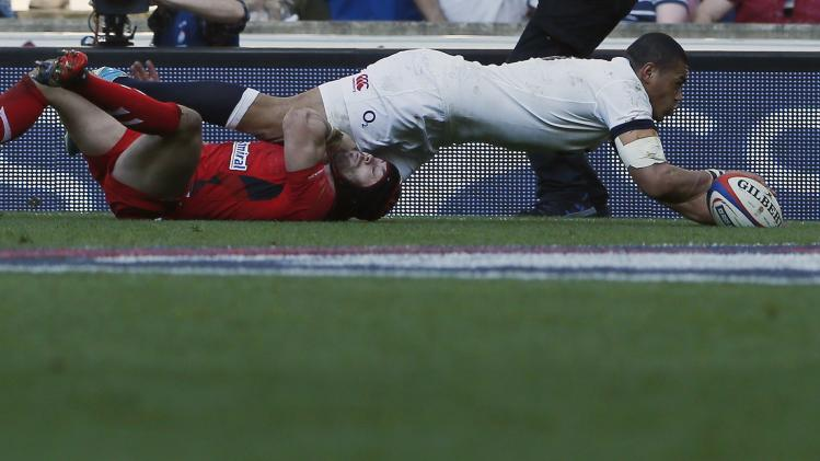 England's Burrell scores a try against Wales during their Six Nations international rugby union match at Twickenham in London