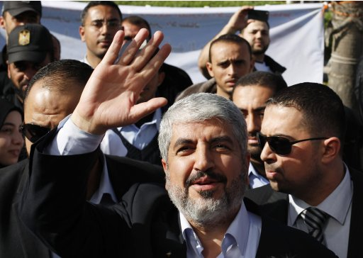 Hamas chief Khaled Meshaal waves upon arrival at Rafah crossing in the southern Gaza Strip