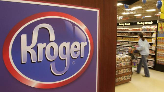 This March 1, 2011 photo shows a customer walking down the bread and pastry aisle at a Kroger Co. supermarket.  The Kroger Co. reported a second-quarter profit that beat Wall Street expectations, Friday, Sept. 7, 2012,  as the supermarket operator said its loyalty program helped lift a key sales figure. The nation's largest traditional grocery store chain also raised its outlook for the year.  (AP Photo/Al Behrman)