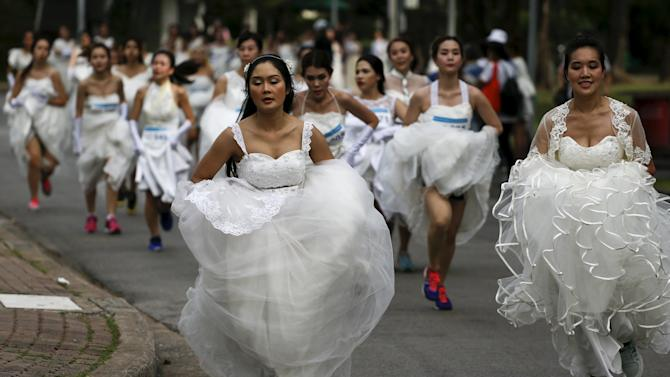 "Brides-to-be participate in the ""Running of the Brides"" race in a park in Bangkok"