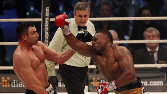 WBC heavyweight Champion Vitali Klitschko, left,  of Ukraine fights with challenger Dereck Chisora of Britain during their WBC heavyweight title boxing bout at the Olympic hall in Munich, southern Germany, Sunday, Feb. 19, 2012. (AP Photo/Matthias Schrader)
