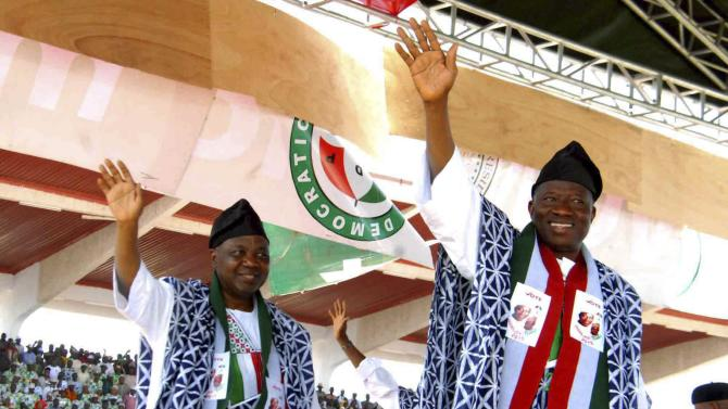 Nigeria's President Jonathan and Vice President Sambo acknowledge cheers from party supporters at the PDP 2015 presidential rally in Jalingo