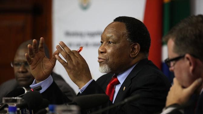 """South Africa's Deputy President Kgalema Motlanthe speaks to foreign journalists at the Union Buildings in Pretoria, South Africa, on Friday, Nov. 30, 2012. Motlanthe says he is """"agonizing"""" over whether he would accept leading the governing African National Congress if he's chosen during the party's convention next month over President Jacob Zuma. Some local ANC groups have nominated Motlanthe to take over leadership of the ANC. Typically, whoever leads the ANC becomes the party's presidential candidate. Elections are slated for 2014. (AP Photo/Jon Gambrell)"""