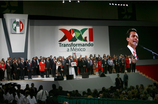 Mexico's President Enrique Pena Nieto delivers a speech during a national convention of the Institutional Revolutionary Party (PRI) in Mexico City, Sunday, March 3, 2013. Mexico's ruling party changed