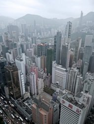 Hong Kong&#39;s skyline is seen here shrouded in a haze of pollution. In the face of mounting public criticism and allegations that it is soft on polluting industry, the government announced its first revision to air quality objectives (AQOs) in 25 years