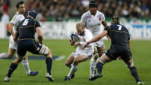 France's Frederic Michalak (C) fights for the ball with Scotland's Alasdair Strokosch (2ndL) and Scotland's Kelly Brown (R) as France's Thierry Dusautoir (2ndR) looks on during their Six Nations rugby union match at the Stade de France