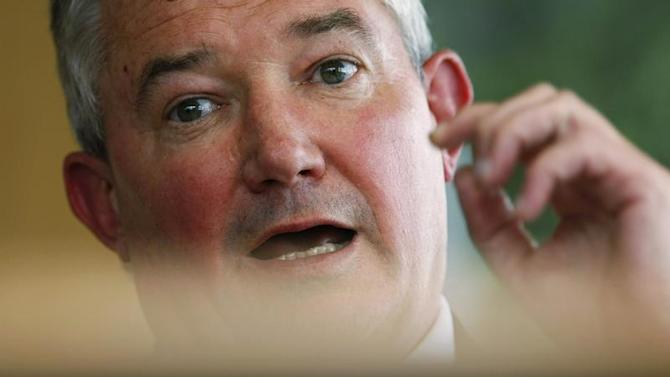 Group Chief Executive of the Bank Of Ireland, Boucher, gestures during an interview with Reuters at the company's head office in Dublin, Ireland