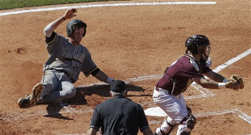 CORRECTS TO MISSISSIPPI STATE'S MITCH SLAUTER NOT NICK AMMIRATI - Vanderbilt's Connor Harrell (20) slides safely into home during a seven-run second inning as Mississippi State's Mitch Slauter, right,