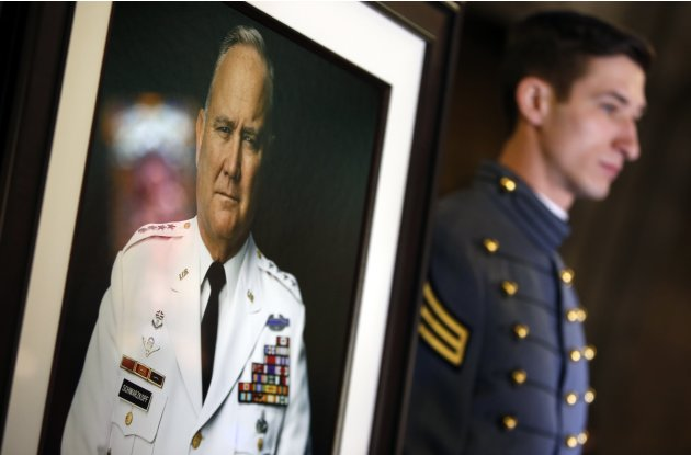 A senior cadet stands next to a portrait of the late U.S. Four Star General Schwarzkopf at West Point before Schwarzkopf's funeral service